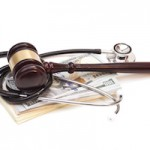 Stethoscope with judge gavel and dollar banknotes on white background
