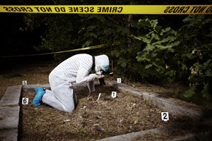A crime scene, person taking photos for investigation