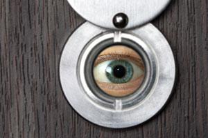 eye looking through peephole
