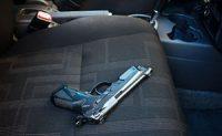 A gun in a car seat