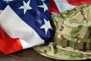 US flag with camouflage cap combat hat